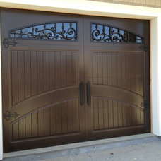 Traditional Garage And Shed by Masterpiece Doors & Shutters