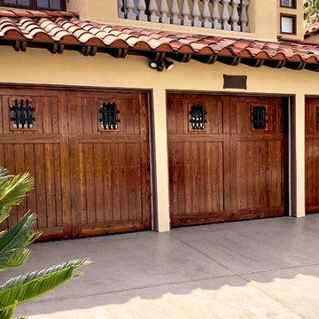 Mediterranean Wood Garage Doors with Iron Accessories