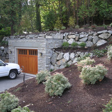 Transitional Garage And Shed by Nyce Gardens