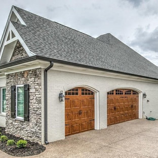 Inspiration for a country attached three-car garage in Louisville.