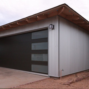 Example of a mid-sized minimalist attached two-car garage design in Phoenix