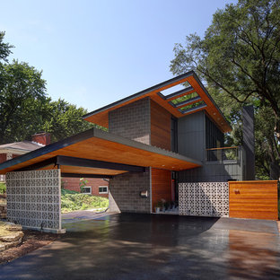 Inspiration for a contemporary attached two-car carport remodel in Milwaukee