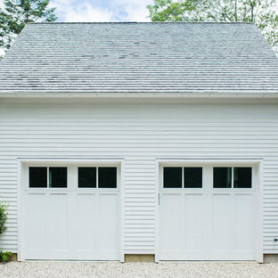 Example of a coastal detached two-car garage design in New York