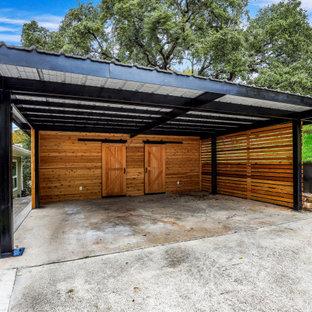 Réalisation d'un grand garage séparé design.