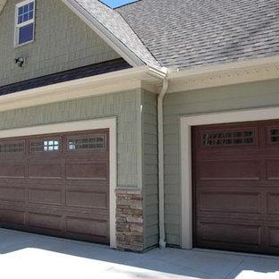 Garage - huge craftsman attached three-car garage idea in Cleveland
