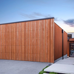 Photo of a contemporary attached double garage in Christchurch.