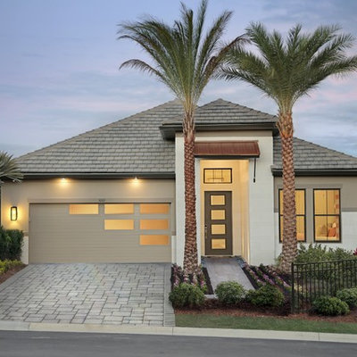 Inspiration for a mid-sized tropical attached two-car garage remodel in Other