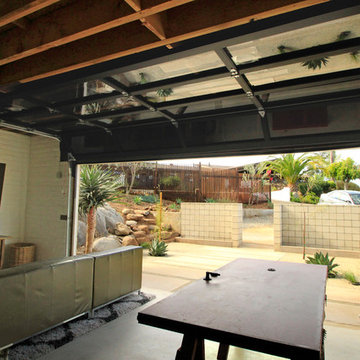 Modern Touch: Glass overhead door for converted garage