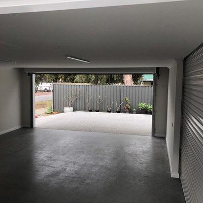Carport - small modern attached two-car carport idea in Perth
