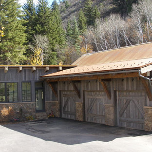 Design ideas for a rustic attached garage in Denver with three or more cars.