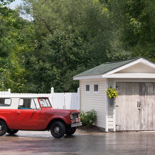 This is an example of a small shabby-chic style detached garage workshop in Cleveland.