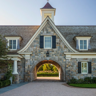 Example of a huge classic attached porte cochere design in Providence