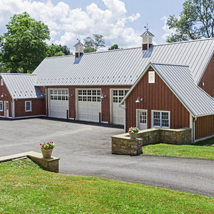 Inspiration for a huge farmhouse detached four-car garage remodel in Other
