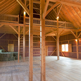 Inspiration for a huge country detached four-car garage remodel in Other