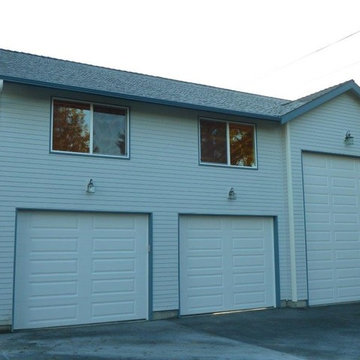 New Construction Garage with a Car Lift and Storage