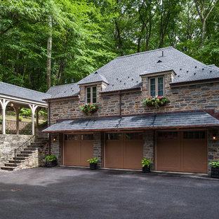 Garage - traditional detached three-car garage idea in Philadelphia