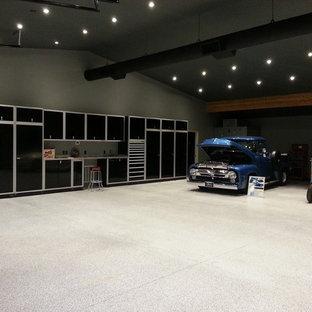 Garage - huge modern detached four-car garage idea in Seattle