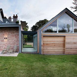 Photo of a medium sized contemporary attached double garage workshop in Cheshire.