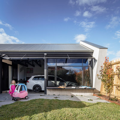 Inspiration for a mid-sized contemporary attached two-car carport remodel in Melbourne