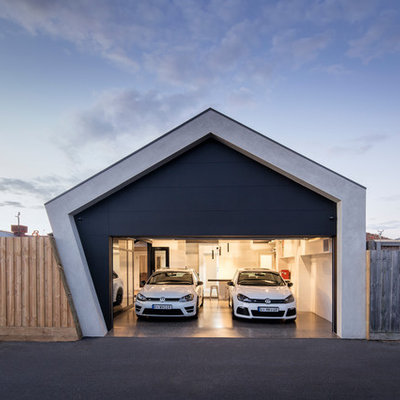 Example of a mid-sized trendy attached two-car carport design in Melbourne