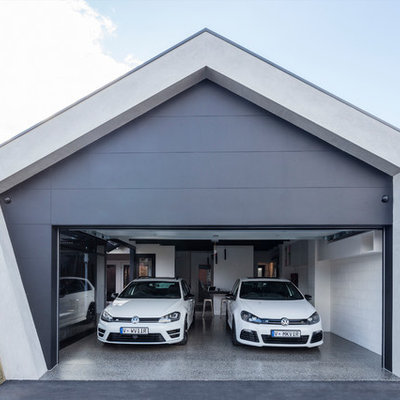 Mid-sized trendy attached two-car carport photo in Melbourne