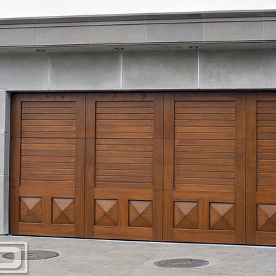 Large transitional two-car garage photo in Orange County