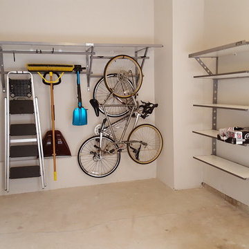 One car garage #shelving organized with Monkey Bars Storage.