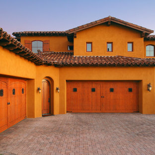 Example of a large southwest attached four-car carport design in Phoenix