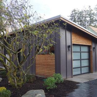 Inspiration för små moderna fristående enbils garager och förråd