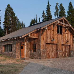 Inspiration for a rustic detached two-car garage remodel in Other