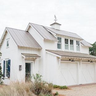 Mid-sized cottage detached two-car garage workshop photo in Charleston
