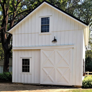 This is an example of a medium sized rural detached garage workshop in Other.