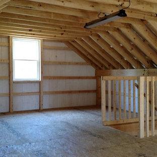 Cette photo montre un garage séparé nature de taille moyenne avec un bureau, studio ou atelier.
