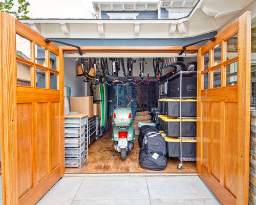 Example Of A Trendy Attached One Car Garage Design In San Diego