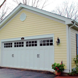 Example of a mid-sized classic detached two-car garage design in Other