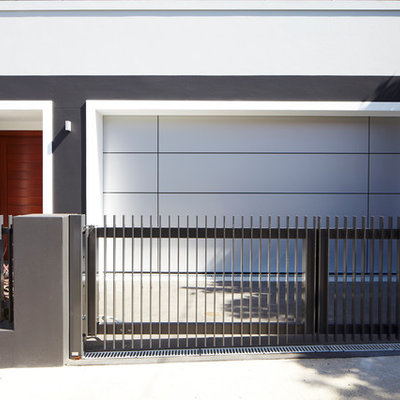 Garage - small contemporary attached two-car garage idea in Sydney