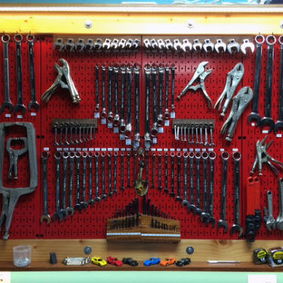 Red Metal Pegboard Meticulously Organized to Perfection