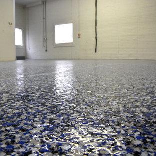 Garage - huge contemporary attached three-car garage idea in Baltimore