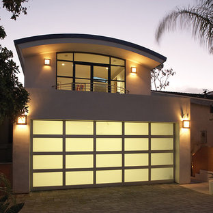 Design ideas for a medium sized modern attached double carport in Orange County.