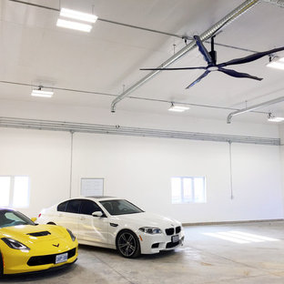 Inspiration for a large industrial attached four-car garage in Toronto.