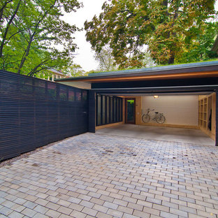 This is an example of a mid-sized modern detached two-car garage in Toronto.