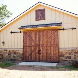 Inspiration for a mid-sized rustic detached one-car garage remodel in Austin