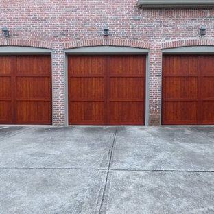 Inspiration for a rustic three-car garage remodel in Atlanta