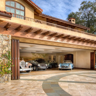 Inspiration for a mediterranean attached four-car garage in San Francisco.