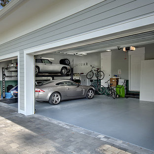 Example of a huge arts and crafts attached three-car garage design in Miami