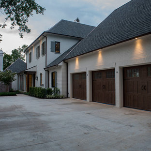 Huge cottage attached three-car garage photo in New Orleans