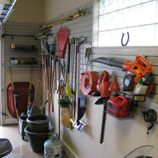 Traditional Garage And Shed by Custom Storage Solutions