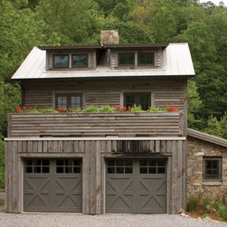 Southern Living 2008 Green Idea House - Clopay Reserve Collection custom Limited Edition Series insulated wood carriage style garage doors, Design 7 with SQ23 windows, as seen on the Southern Living Green Idea House. Grooved cedar doors custom painted by builder.