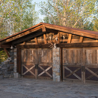 Example of a mountain style detached two-car garage design in Other