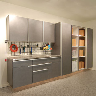 Small trendy attached garage workshop photo in Orange County